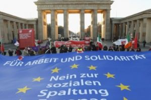 A protest with the flag of the European Union in Germany